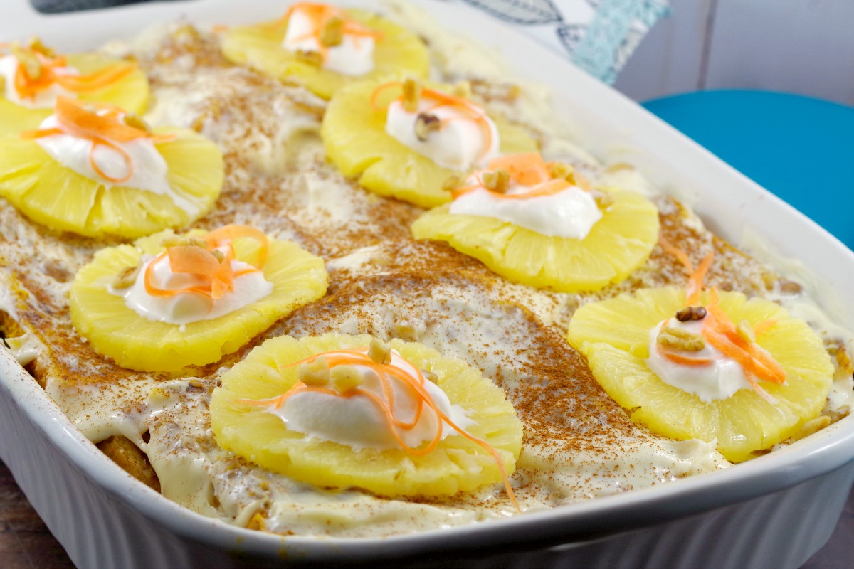 Whole Carrot Cake French Toast Casserole with pineapples dotted with whipped cream and grated carrots on top