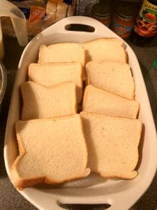 bread overlapping in two rows in casserole dish