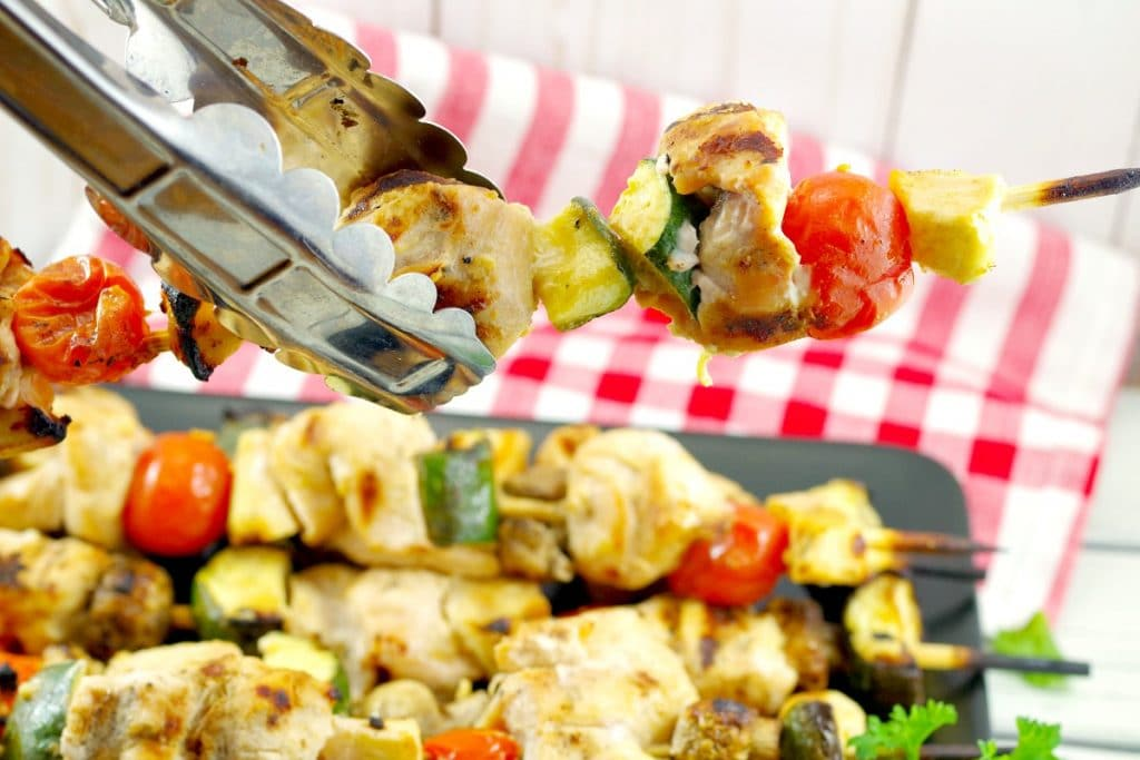 kabob being held with tongs