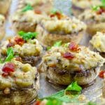 easy pierogi stuffed mushrooms on a baking sheet covered with foil