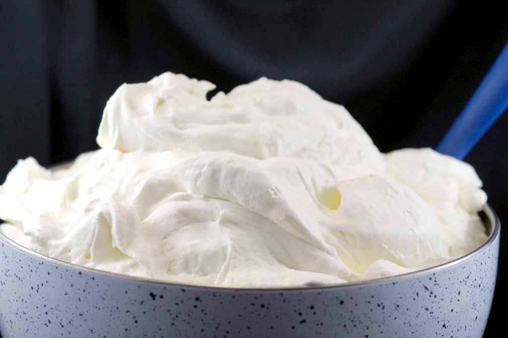 top of speckled bowl of white whipped cream frosting