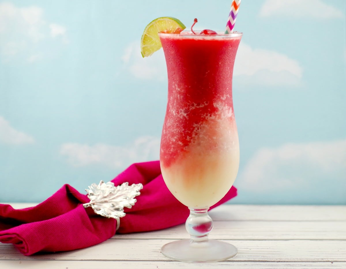 Miami Vice mocktail with red napkin with Canadian Maple Leaf in background