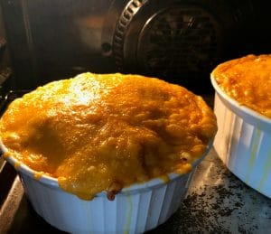 Mac and cheese with tomatoes baking in the oven