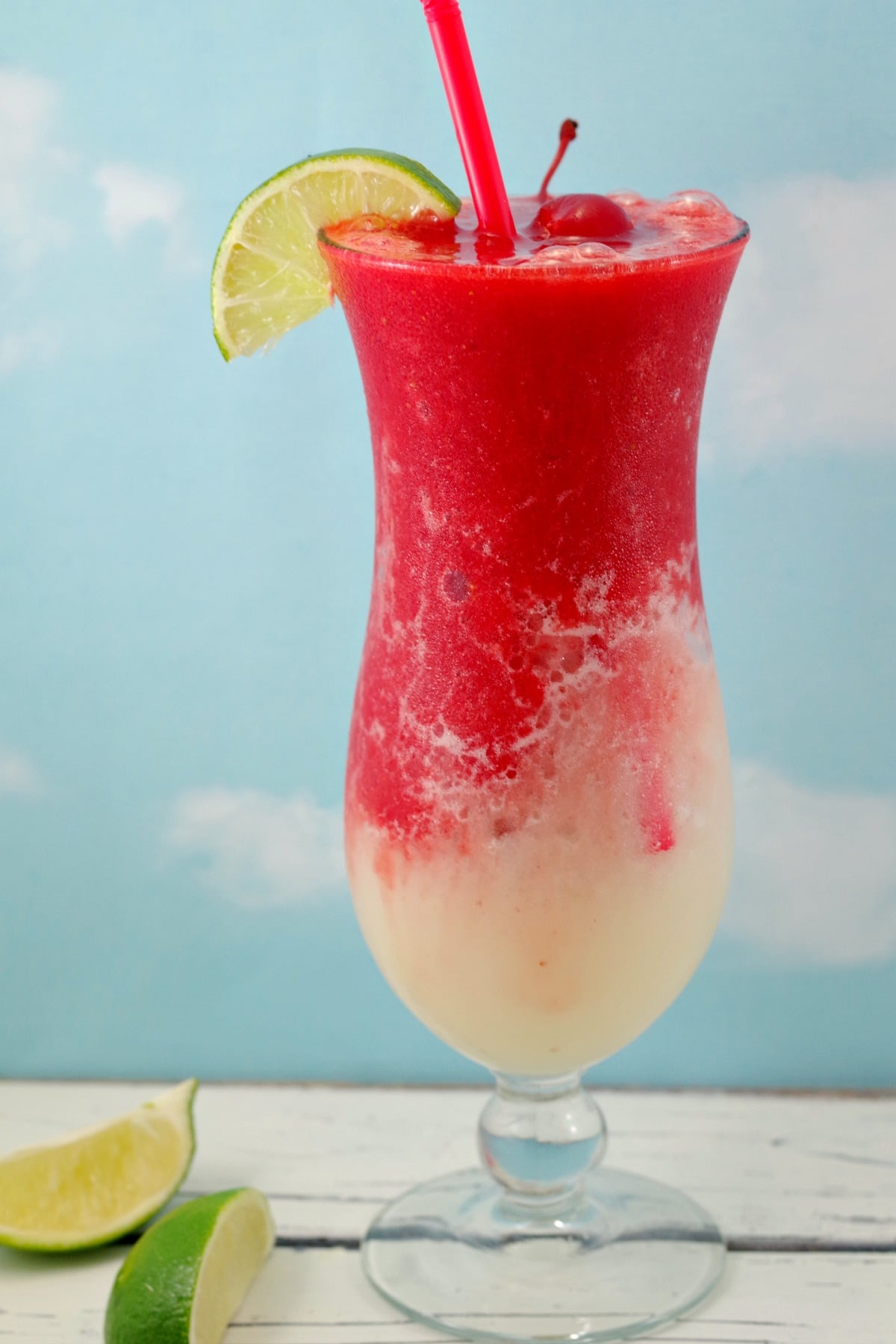 Miami Vice Mocktail with lime and cherry garnish