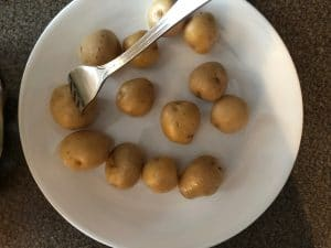 creamer potatoes being poked with a fork