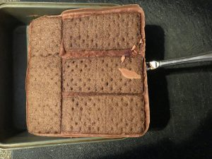ice cream sandwiches being lifted out of pan