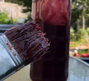 Saskatoon Berry BBQ sauce bottle and BBQ brush