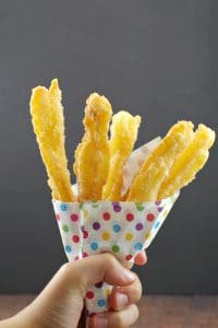 Churros in carnival style colored polka dot paper holder