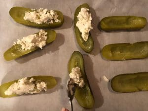 Boursin cheese mixture spooned into pickles