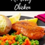 Pinterest pin with text at the top and bottom and a photo of monterey chicken on a black plate with baked potato, mixed vegetables and lemon wedges