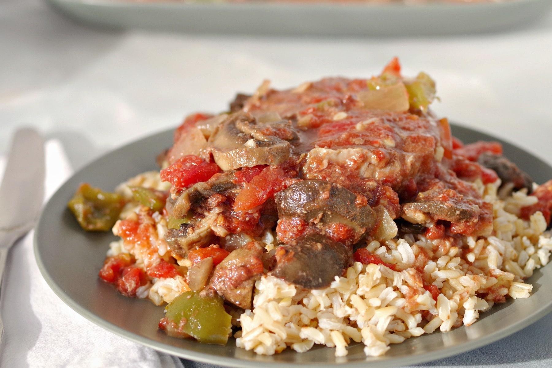 Slow Cooker Swiss Steak on Rice (on green plate)