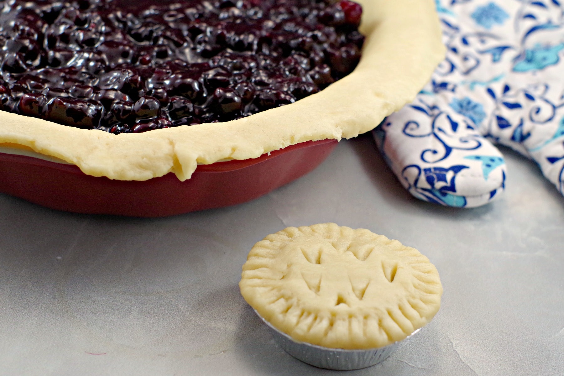 Saskatoon berry filling in pie crust with tart in foreground