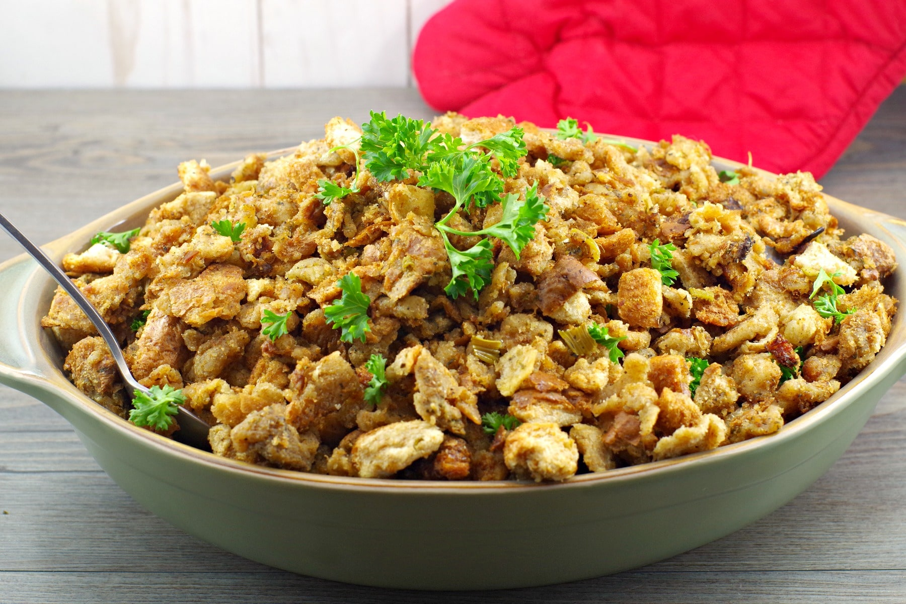 Old fashioned bread stuffing in green dish