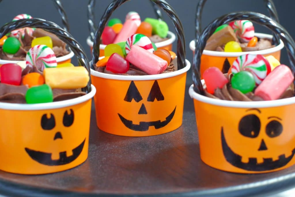 Halloween Jack o'latern cupcakes on a black platter