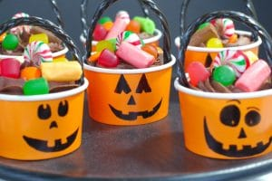 Halloween Jack o'latern cupcakes on a black platter
