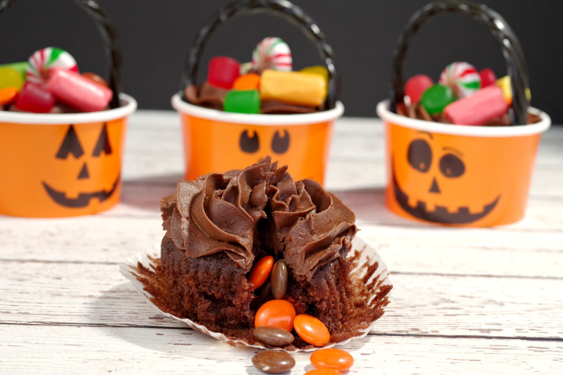 Halloween Pinata cupcake with candy spilling out of cupcake