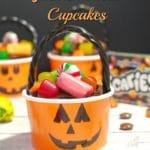 Halloween Jack o'lantern bucket cupcake with candy strewn around