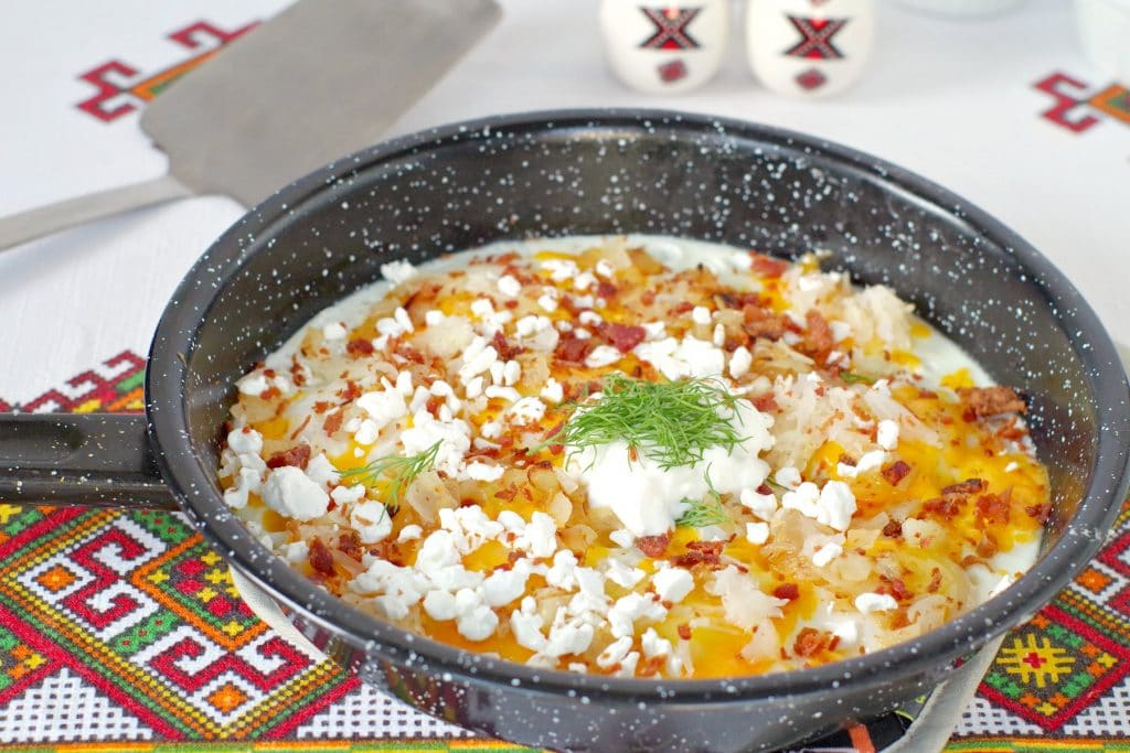 Ukrainian style eggs in frying pan