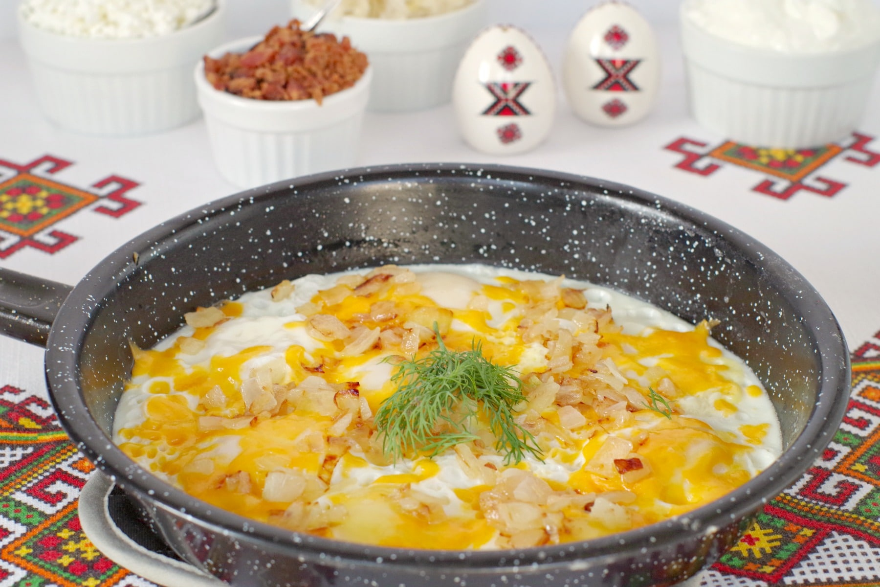Ukrainian style eggs in foreground with toppings in background