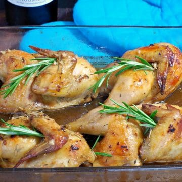 Cornish hens with wine sauce in glass baking dish