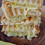 Weight Watchers turkey reuben panini on platter with pickle