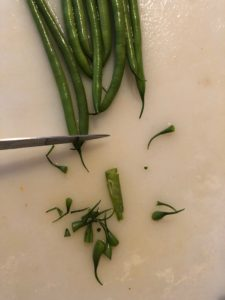 beans with stringy ends being cut off