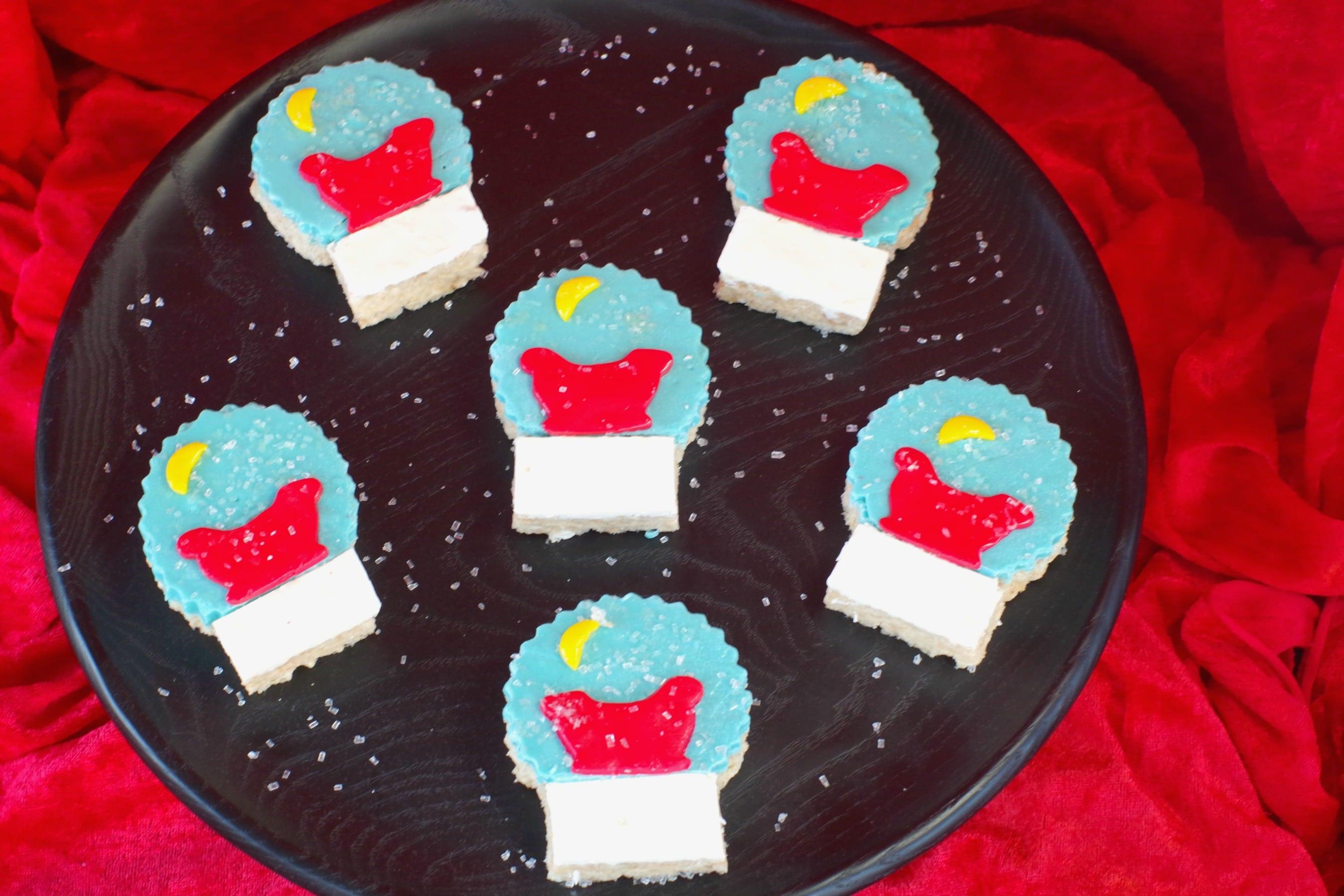 snow globe rice krispie treats on black tray