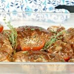 Balsamic chicken with tomatoes in a glass dish