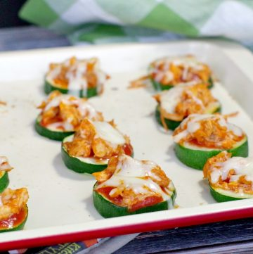 Zucchini pizza bites on off-white baking tray