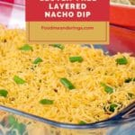 layered nacho dip in glass pan