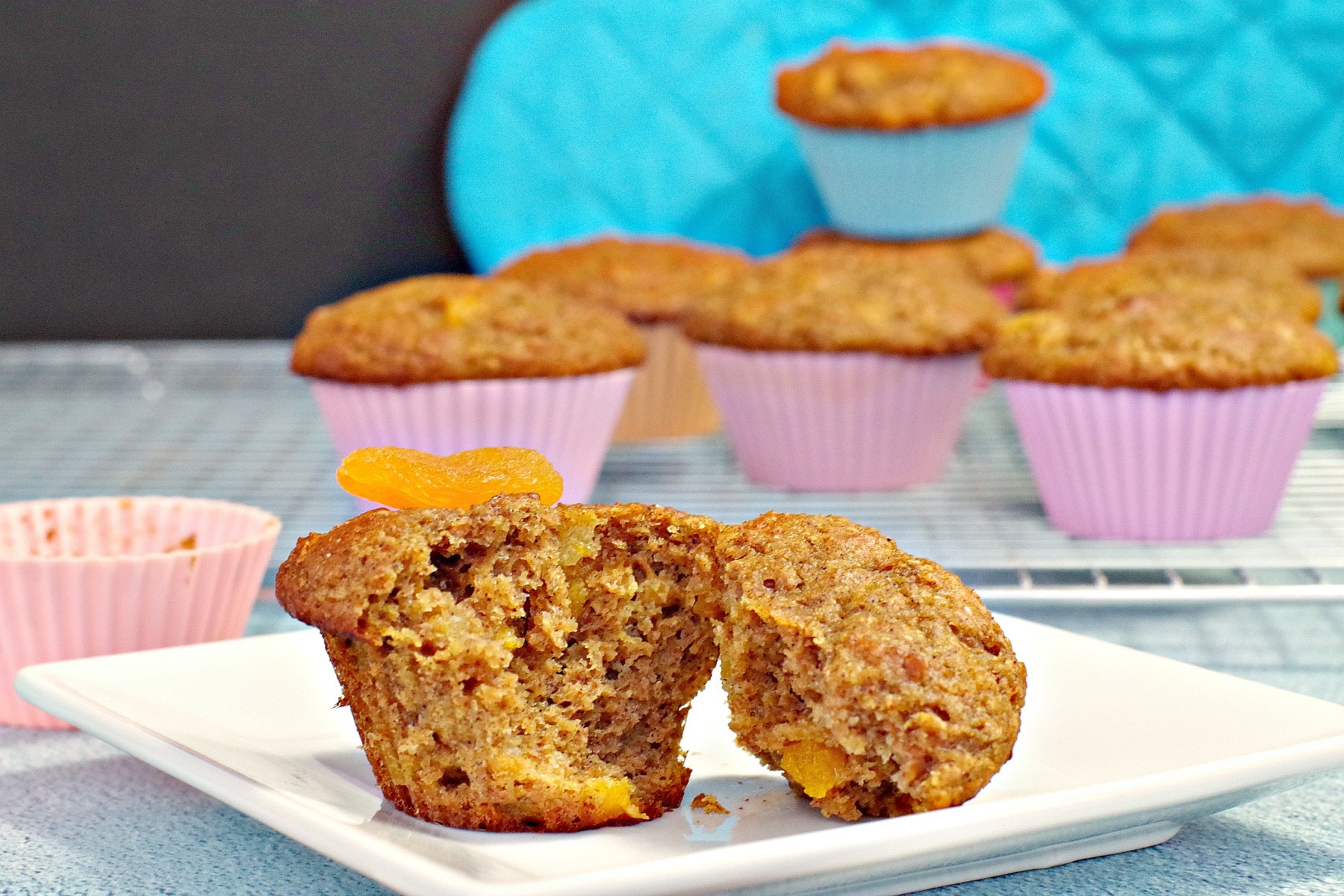 Muffin split in half with more muffins in background