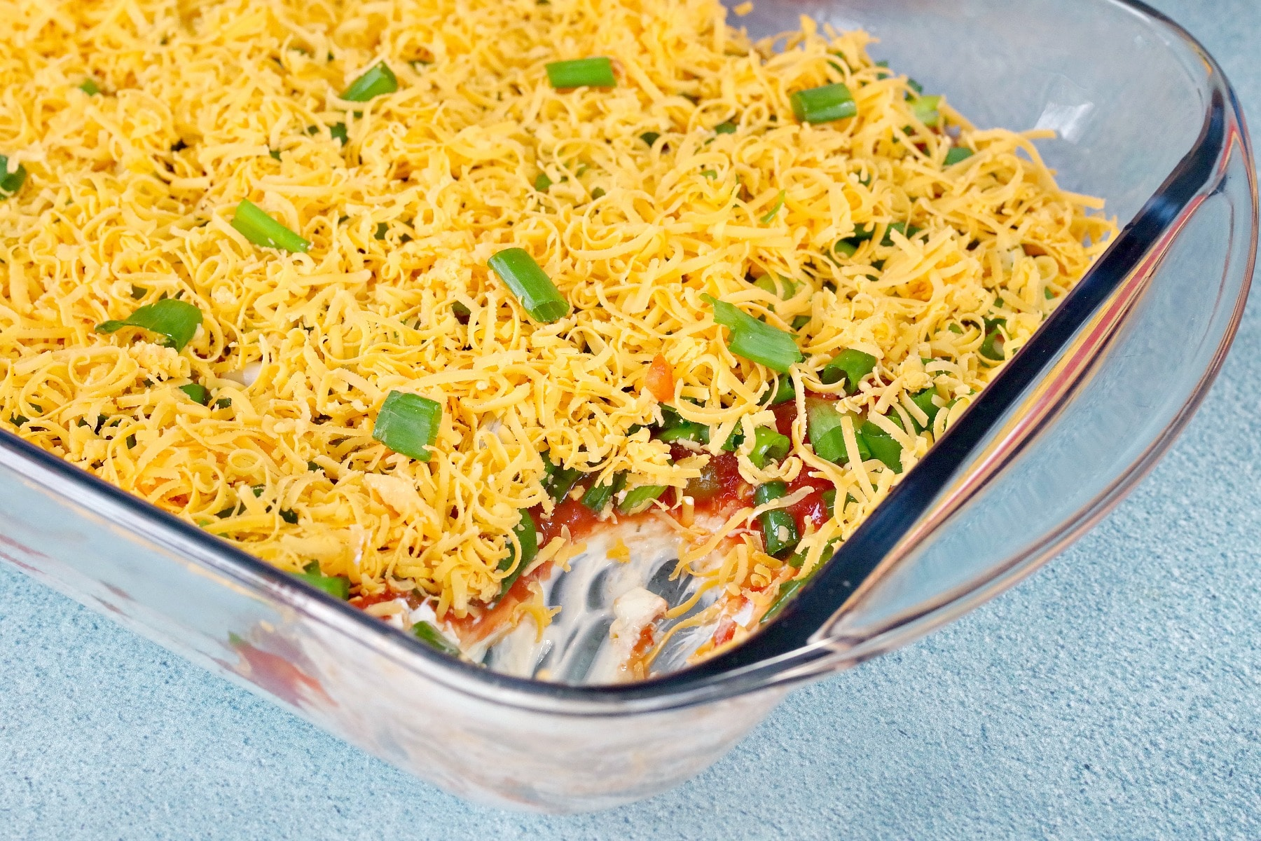 layered nacho dip with layers showing