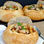3 bread bowls filled with Panzanella Pasta Soup (back 2 on black tray)