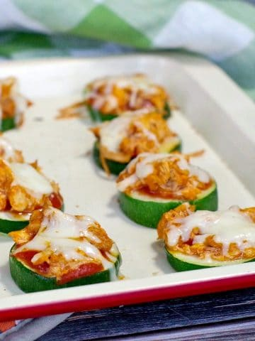 buffalo chicken zucchini pizza recipe on an off-white baking tray