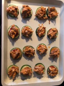 zucchini bites with buffalo chicken on top