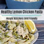 Creamy Lemon Chicken Pasta in a bowl with lemon wedges and blue ceramic pot in background