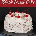 Pinterest pin with white text on red background on the top and bottom and a whole black forest cake with cherries in the middle
