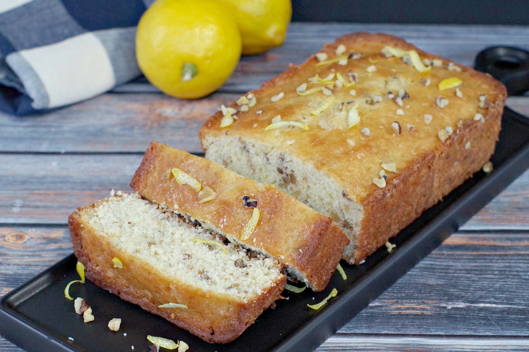 sliced lemon loaf on black tray