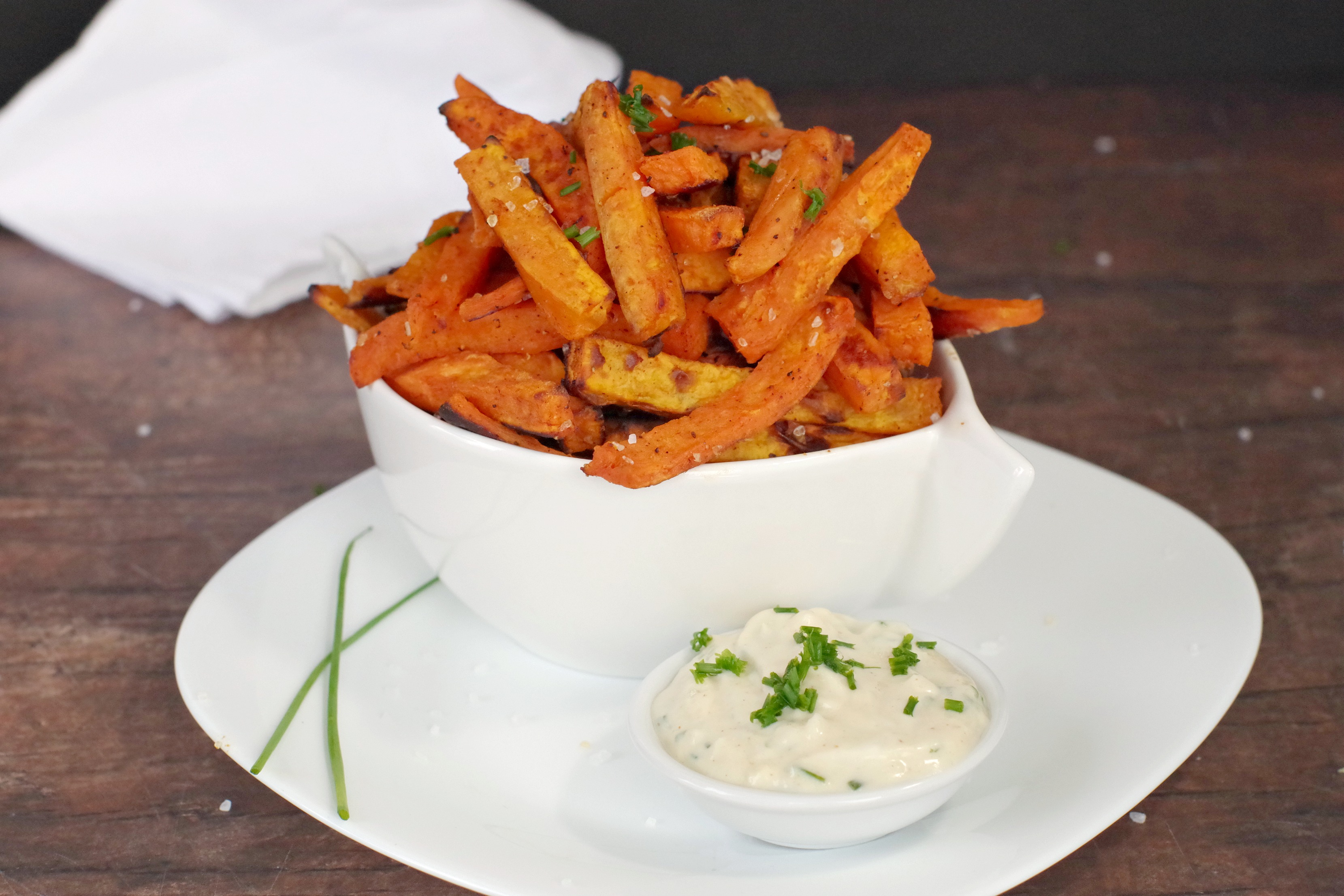 Sweet potato fries and dip in white plate on white bowl