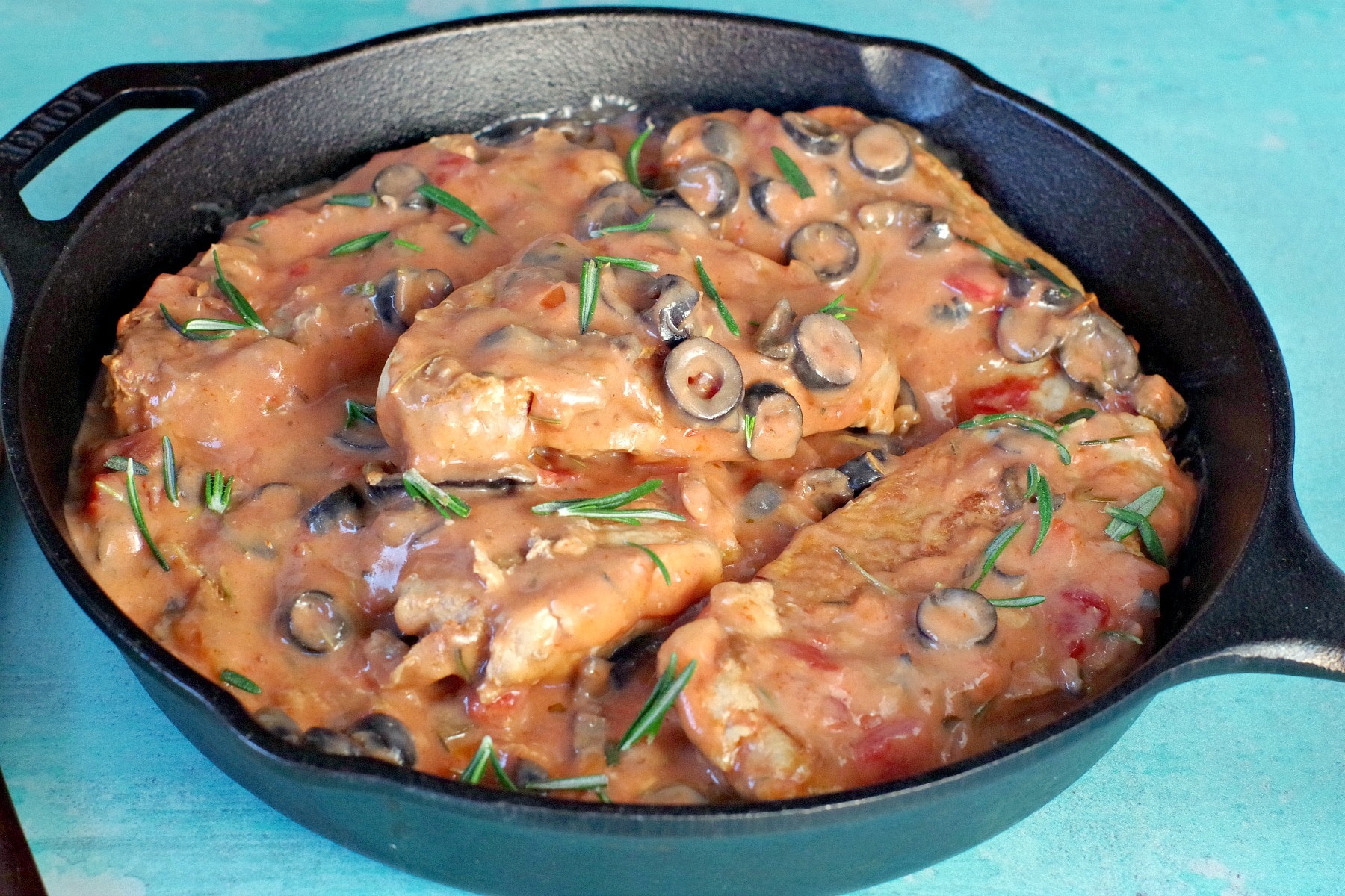Pork with creamy mushroom salsa sauce in cast iron pan