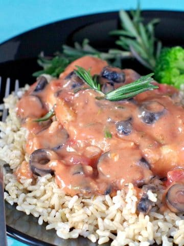 Pork with Creamy mushroom salsa sauce on bed of rice with frozen broccoli