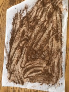 cocoa sprinkled on parchment