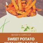 pinterest pin with text at bottom and photo of sweet potato fries in white bowl with garlic dip in small white dipping bowl in front of fries