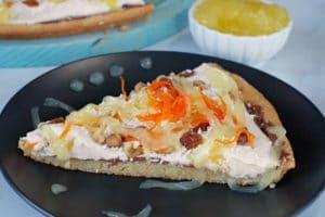 slice of carrot cake dessert pizza with glaze