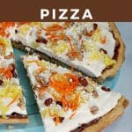 Pinterest pin with white text on brown background and photo of carrot cake dessert pizza with a slice being removed