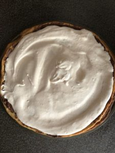 whipped cream mixture spread over chocolate cream cheese