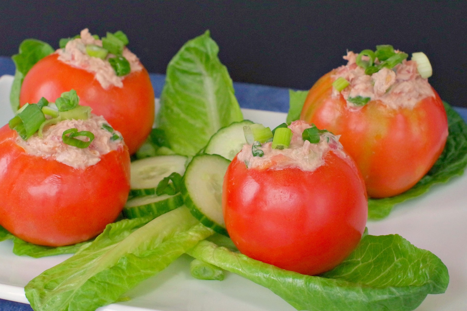 Stuffed Tomatoes with Tuna on platter with lettuce and cucumbers