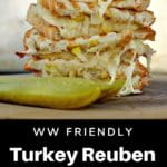 stacked WW friendly turkey reuben with a pickles on top