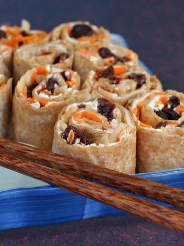 raisin sushi with chopsticks
