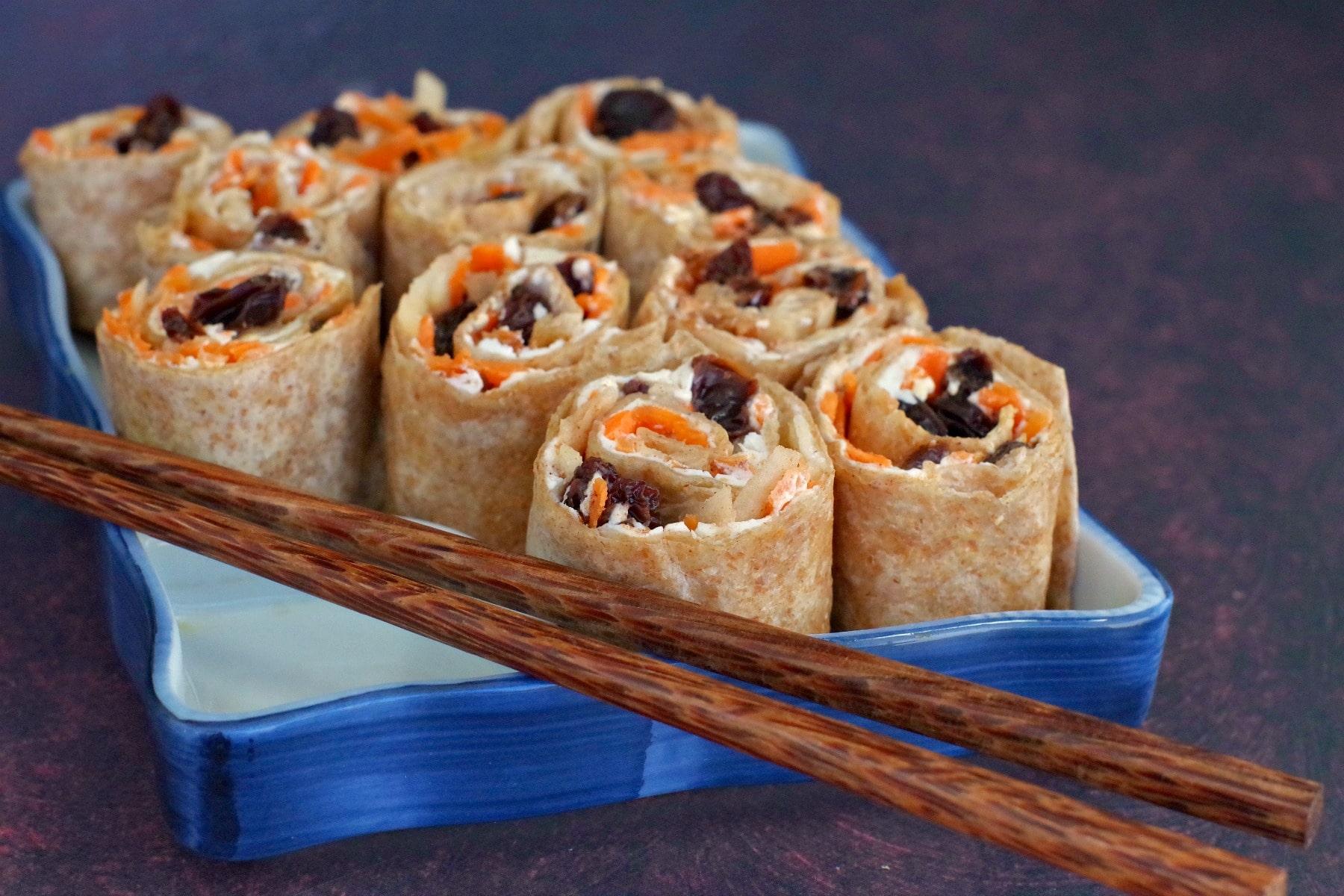 raisin sushi on sushi tray with chopsticks